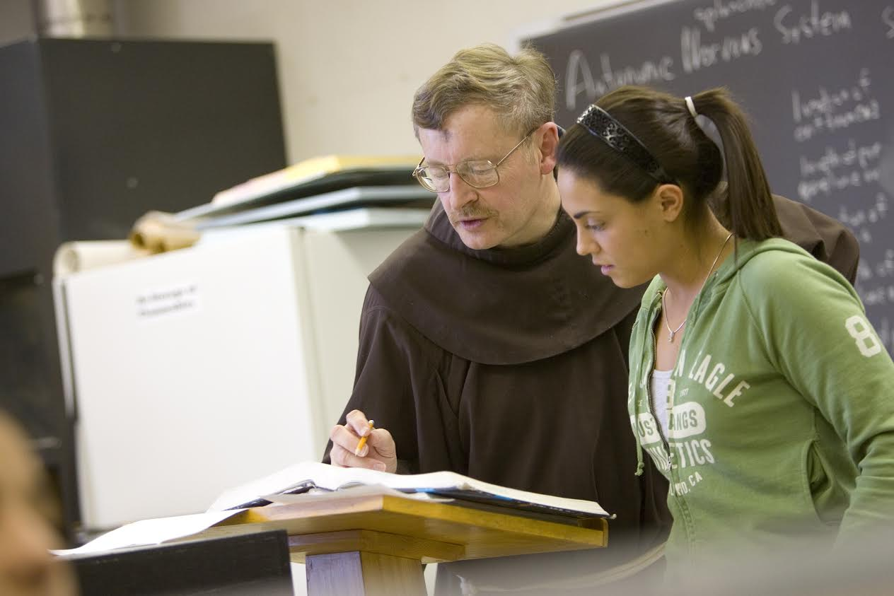 Fr Peter Schneible and Student